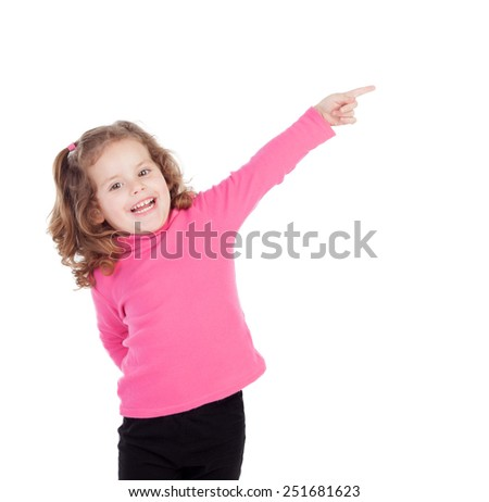 Little girl in pink indicating something isolated on a white background - stock photo