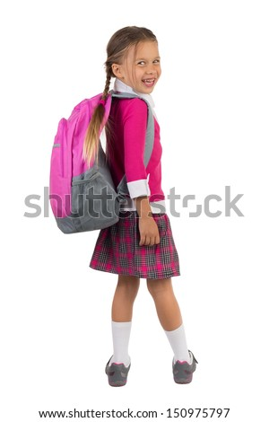 Little girl in pink school uniform with a backpack looking over right shoulder and laughing, isolated - stock photo
