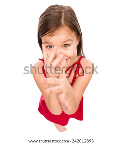 Little girl in red dress showing big nose, mocking, fisheye portrait, isolated over white - stock photo