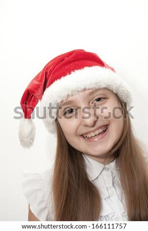 little girl in red santa hat  - stock photo