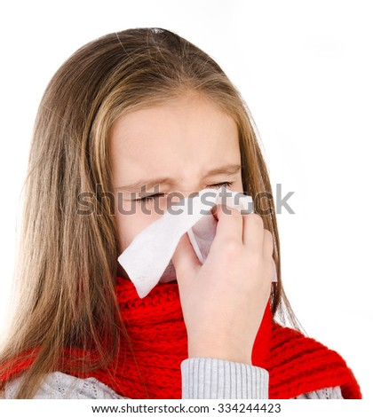 Little girl in red scarf blowing her nose in a great effort closeup isolated on white - stock photo