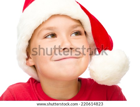 Little girl in santa hat is daydreaming, isolated over white - stock photo