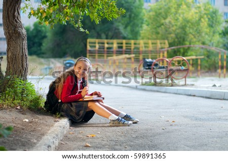 Little girl in school - stock photo