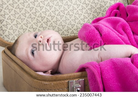 little girl in suitcase	 one month baby girl in a vintage suitcase - stock photo