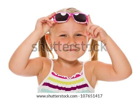 little girl in sunglasses. studio shot - stock photo