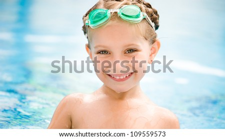 Little girl in swimming pool close-up. - stock photo
