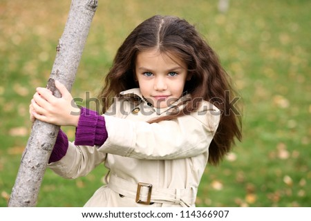 little girl in the autumn park - stock photo