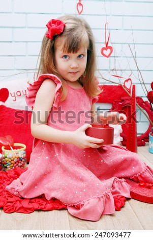 Little girl in the festive decor for Valentine's Day - stock photo