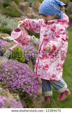 Little girl in the garden - stock photo