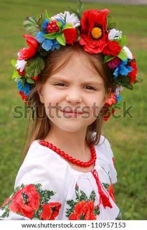 little girl in traditional ukrainian costume/historical costume on a pretty child - stock photo