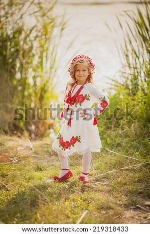 Little girl in Ukrainian national costume - stock photo