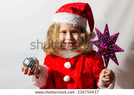 Little girl in winter hat with gloves and scarf on a white background. - stock photo