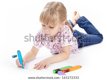Little girl is drawing with colored markers - stock photo