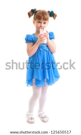 Little girl is drinking milk of glasses in she hands on white background. - stock photo