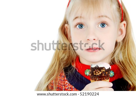 Little girl is eating chocolate ice-cream. Isolated over white background. - stock photo