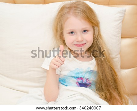 little girl is feeling better from the medical treatment - stock photo