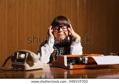 Little girl is having headache because she is tired of work - stock photo