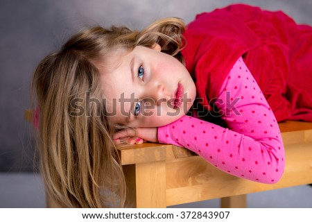 little girl is in bad mood and looking sad - stock photo