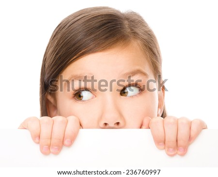 Little girl is looking from out blank board, isolated over white - stock photo