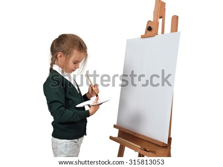 little girl is painting on blank easel on a white background - stock photo