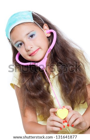 Little girl is playing doctor isolated on white - stock photo