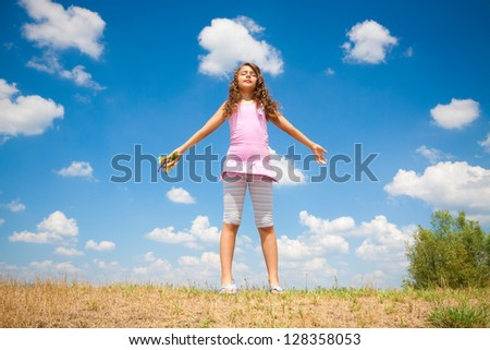 little girl is relaxing in nature - stock photo