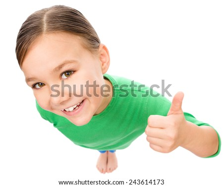 Little girl is showing thumb up gesture, fisheye portrait, isolated over white - stock photo