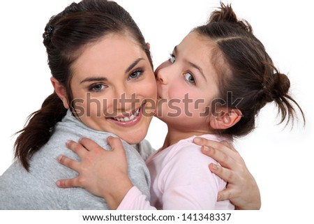 little girl kissing her mother - stock photo