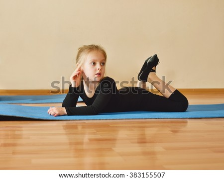 little girl laying on the floor and having rest - stock photo