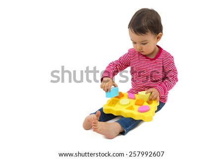 little girl learning shapes, early education and daycare concept - stock photo