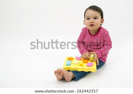 little girl learning shapes, early education and daycare concept isolated - stock photo