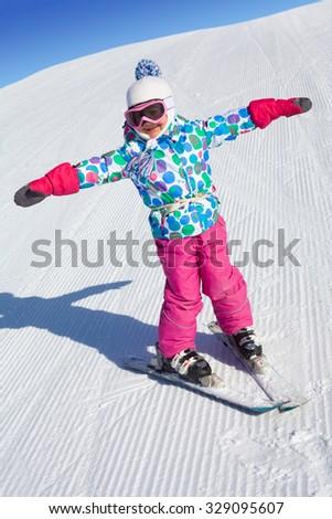 little girl learning to ski at the ski resort - stock photo