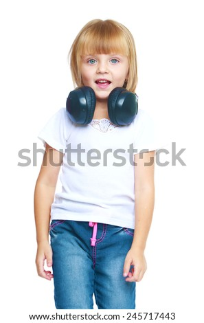Little girl listening to music on headphones.Isolated on white background - stock photo