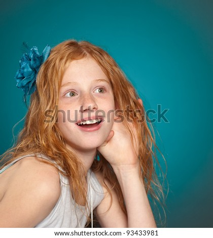 Little girl listens excitedly with her hand to her ear. - stock photo
