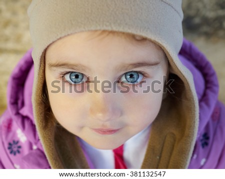 Little girl look to close-up. Portrait of child face. - stock photo