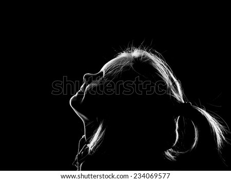 Little girl looking up - stock photo