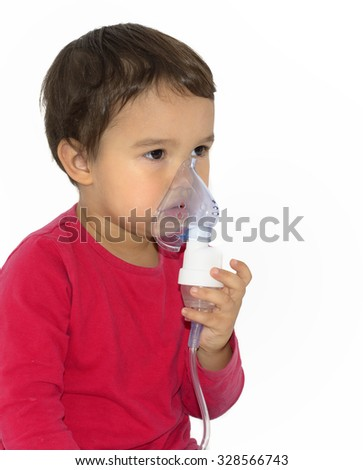 Little girl making aerosol treatment with a rubber masks - stock photo