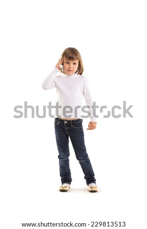 little girl making phone call using smartphone on white background - stock photo