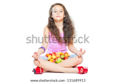 little girl meditates and healthy food isolated on white - stock photo