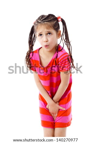 Little girl need a pee, isolated on white - stock photo