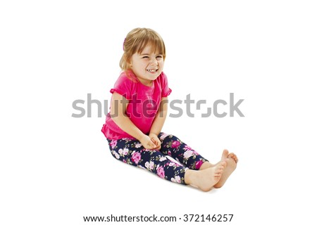 Little girl need a pee. Isolated on white background - stock photo