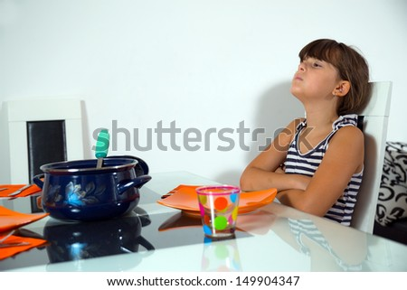 little girl not wanting to eat - stock photo