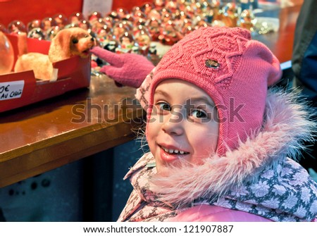 little girl on a Christmas market - stock photo