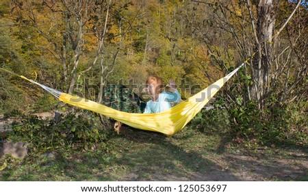Little girl on a hammock - stock photo