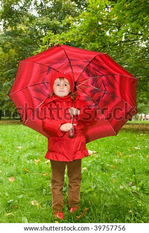 little girl on an umbrella in park - stock photo