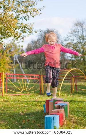 little girl on playground - stock photo