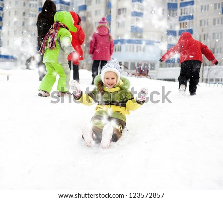 Little girl on the ice slide - stock photo