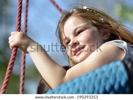 Little girl on the playground having fun - stock photo