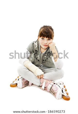 Little girl on the rollerblades with broken arm. Isolated on white background  - stock photo