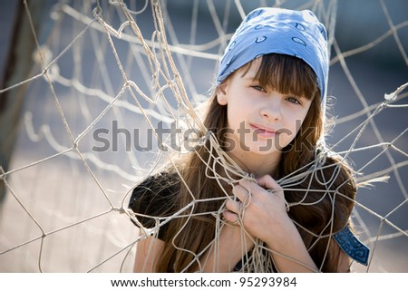 little girl on the street - stock photo